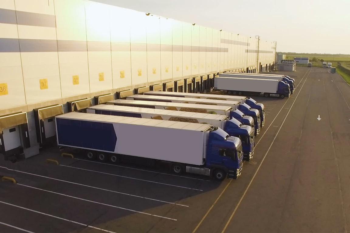 distribution warehouse with trucks awaiting loading